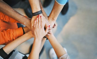bigstock-Sea-Of-Hands-Showing-Unity-And-61933913